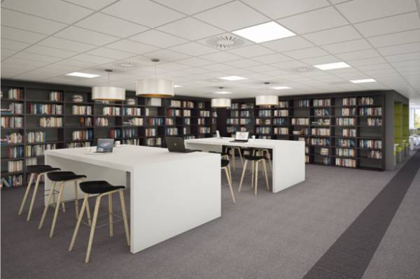 Office Photo with Desks surrounded by Book Shelves with Grey Carpet tiles